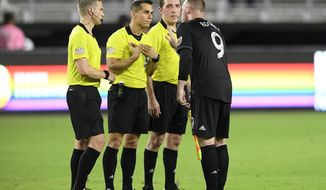 D.C. United forward Wayne Rooney (9) talks to the officials following the team's MLS soccer match against the New York Red Bulls, Wednesday, July 25, 2018, in Washington. The Red Bulls won 1-0. (AP Photo/Nick Wass)
