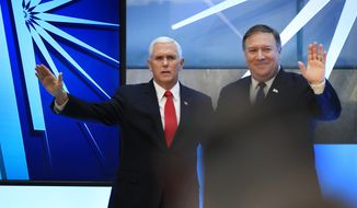 Vice President Mike Pence and Secretary of State Mike Pompeo, right, wave following a speech by Pence at the close of a three-day conference on religious freedom at the State Department in Washington, Thursday, July 26, 2018, as the Trump administration comes under criticism for strict refugee and migration policies that have sharply reduced America's intake of people fleeing persecution over their beliefs. (AP Photo/Manuel Balce Ceneta)