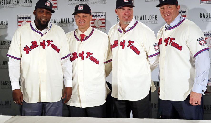 FILE - In this Jan. 25, 2018, file photo, Baseball Hall of Fame inductees, from left, Vladimir Guerrero, Trevor Hoffman, Chipper Jones and Jim Thome, pose during a news conference in New York. Induction ceremonies will be Sunday, July 29, 2018. (AP Photo/Frank Franklin II, File)