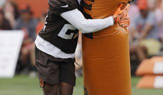 Cleveland Browns defensive back Denzel Ward runs a drill during NFL football training camp, Thursday, July 26, 2018, in Berea, Ohio. (AP Photo/Tony Dejak)