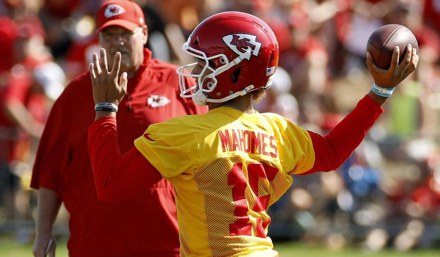 Kansas City Chiefs quarterback Patrick Mahomes (15) throws during NFL football training camp Thursday, July 26, 2018, in St. Joseph, Mo. (AP Photo/Charlie Riedel)