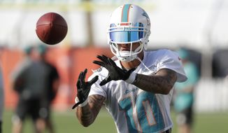 Miami Dolphins wide receiver Kenny Stills (10) does drills Thursday, July 26, 2018, at the NFL football team's training camp in Davie, Fla. (AP Photo/Lynne Sladky)
