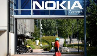 Headquarters of Finnish telecommunication network company Nokia pictured in Espoo, Finland, Thursday July 26, 2018. Nokia announced it's second quarter 2018 financial results on Thursday. (Mikko Stig/Lehtikuva via AP)