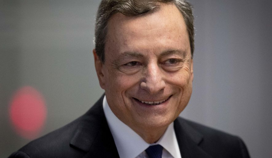 President of European Central Bank Mario Draghi is on his way to a news conference after a meeting of the ECB governing council in Frankfurt, Germany, Thursday, July 26, 2018. (AP Photo/Michael Probst)