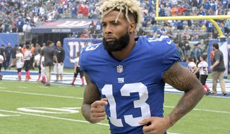 FILE - In this Oct. 8, 2017, file photo, New York Giants wide receiver Odell Beckham warms up prior to an NFL football game against the Los Angeles Chargers, in East Rutherford, N.J. The Giants are planning to start contract negotiations with star receiver Odell Beckham Jr.  Giants co-owner John Mara said Thursday, July 26, 2018, the talks with Beckham and his representatives will take place sooner rather than later. (AP Photo/Bill Kostroun, File)