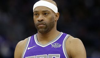 FILE - In this April 11, 2018, file photo, Sacramento Kings guard Vince Carter is shown during the second half of an NBA basketball game against the Houston Rockets, in Sacramento, Calif. A person familiar with the deal says veteran Vince Carter has agreed to a one-year, $2.4 million contract with the Atlanta Hawks.The person spoke to The Associated Press Thursday, July 26, 2018, on condition of anonymity because the deal has not been announced. (AP Photo/Rich Pedroncelli, File)