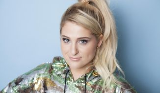 "Meghan Trainor poses for a portrait at Hotel Amarano, Thursday, July 26, 2018, in Los Angeles to promote her upcoming album, ""Treat Myself."" (Photo by Rebecca Cabage/Invision/AP)"