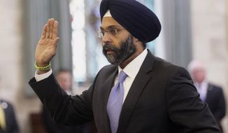 """FILE - In this Jan. 16, 2018, file photo, Gurbir Grewal is sworn in before testifying in front of the senate judiciary committee in Trenton, N.J. WKXW-FM radio hosts Dennis Malloy and Judi Franco are receiving heavy criticism for repeatedly referring to Grewal, the state's attorney general, as """"turban man"""" on air, Wednesday, July 25, The Record reports. (Chris Pedota/The Record via AP, File)"""