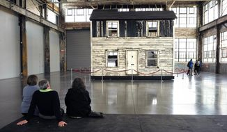 FILE - In this April 1, 2018 file photo, visitors view the rebuilt house of Rosa Parks at the WaterFire Arts Center in Providence, R.I. The house where Parks sought refuge in Detroit after fleeing the South will be auctioned on Thursday, July 26 in New York, with a minimum bid of $1 million. (AP Photo/Steven Senne, File)