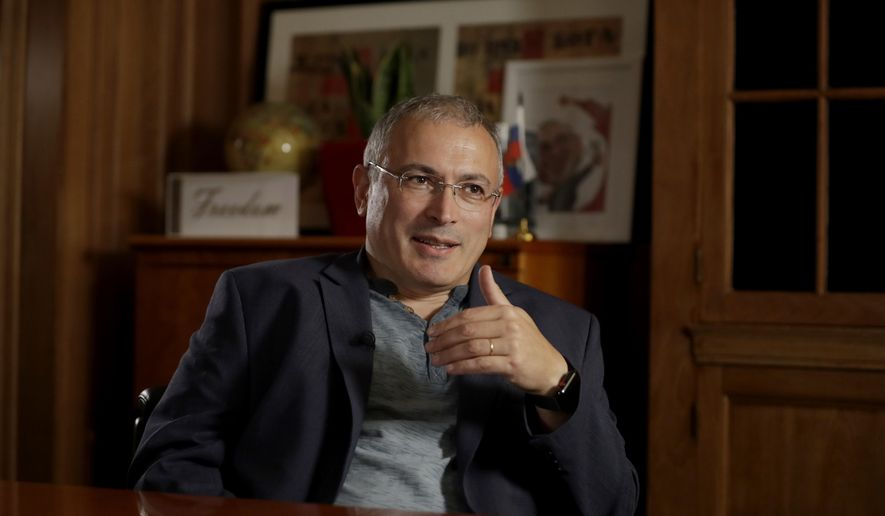 Russian opposition figure Mikhail Khodorkovsky, the former owner of the Yukos Oil Company, speaks during an interview by The Associated Press in London, Tuesday, July 24, 2018. Khodorkovsky's London-based investigative unit, the Dossier Center, is compiling profiles of Russians it accuses of benefiting from corruption with an eye toward their eventual prosecution. (AP Photo/Matt Dunham) **FILE**