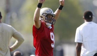 New Orleans Saints quarterback Drew Brees (9) reacts during NFL football practice in Metairie, La., Thursday, July 26, 2018. (AP Photo/Jonathan Bachman)