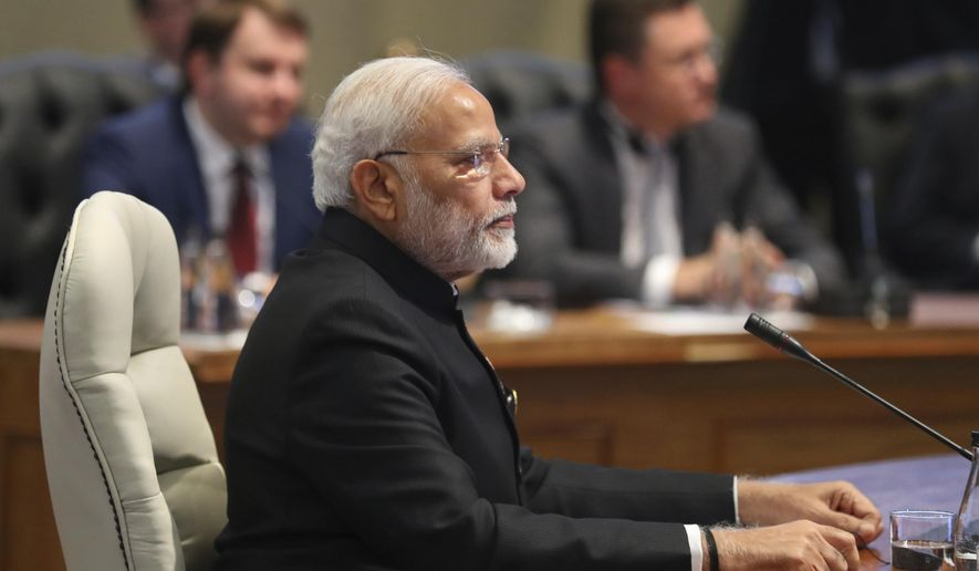 Indian Prime Minister Narendra Modi attends the BRICS summit of major emerging national economies, in Johannesburg, South Africa, Thursday, July 26, 2018. The five leaders of the BRICS emerging economies have gathered in South Africa for an annual summit. (Mike Hutchings/Pool via AP) ** FILE **