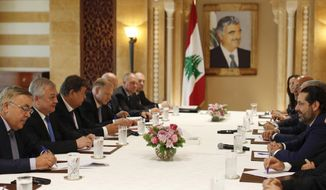 Russia's special presidential envoy to Syria Alexander Lavrentiev, second left, and Russian Deputy Foreign Minister Sergei Vershinin, left, meet with Lebanese Prime Minister-designate Saad Hariri, right, at his house in downtown Beirut, Lebanon, Thursday, July 26, 2018. The Russian delegation is in Lebanon to discuss Russian proposals for organizing the return of Syrian refugees from Lebanon and Syria to their homes in Syria. (AP Photo/Hassan Ammar)