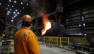 In this June 28, 2018 photo, senior melt operator Randy Feltmeyer watches a giant ladle as it backs away after pouring its contents of red-hot iron into a vessel in the basic oxygen furnace as part of the process of producing steel at the U.S. Steel Granite City Works facility in Granite City, Ill. President Donald Trump will visit the facility on Thursday, July 26, 2018. U.S. Steel credited Trump's plan to impose tariffs on imported steel and aluminum when the company announced in March it was firing up a furnace at Granite City Works that had been idled for more than two years. (AP Photo/Jeff Roberson)
