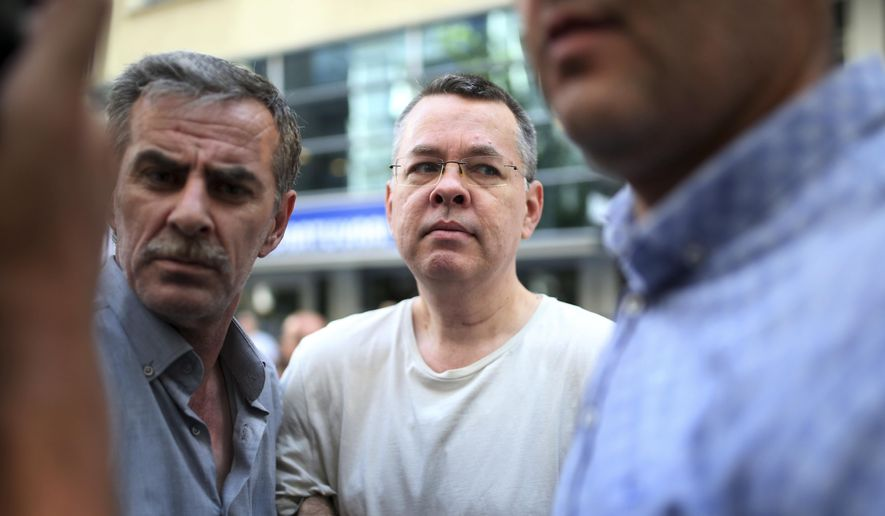 In this July 25, 2018, file photo, Andrew Craig Brunson, an evangelical pastor from Black Mountain, North Carolina, arrives at his house in Izmir, Turkey.  An American pastor who had been jailed in Turkey for more than one and a half years on terror and espionage charges was released Wednesday and will be put under house arrest as his trial continues. (AP Photo/Emre Tazegul) ** FILE **