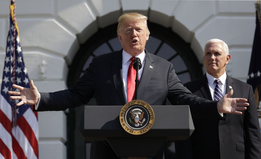 President Donald Trump delivers remarks on the economy at the White House, Friday, July 27, 2018, in Washington. Vice President Mike Pence is at right.  (AP Photo/Evan Vucci)