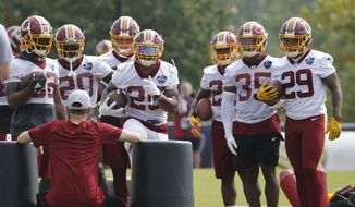 Washington Redskins running back Chris Thompson (25) runs a drill during the morning session of the Redskins NFL football training camp in Richmond, Va., Friday, July 27, 2018. (AP Photo/Steve Helber) **FILE**