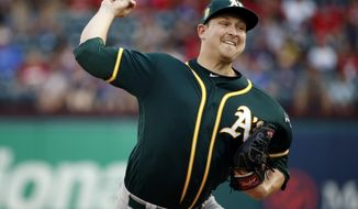Oakland Athletics starting pitcher Trevor Cahill (53) pitches to the Texas Rangers during the first inning of a baseball game Thursday, July 26, 2018, in Arlington, Texas. (AP Photo/Michael Ainsworth)