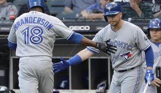 Toronto Blue Jays' Curtis Grandson, left, celebrates with Justin Smoak after hitting a solo home run against the Chicago White Sox during the first inning of a baseball game Friday, July 27, 2018, in Chicago. (AP Photo/Nam Y. Huh)