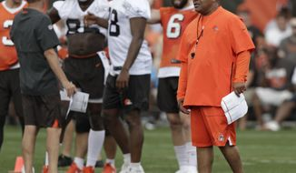 Cleveland Browns head coach Hue Jackson watches an NFL football training camp, Friday, July 27, 2018, in Berea, Ohio. (AP Photo/Tony Dejak)