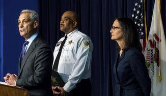 Chicago Mayor Rahm Emanuel, left, speaks with Illinois Attorney General Lisa Madigan, right, and Chicago Police Superintendent Eddie Johnson during a news conference for the release of the draft consent decree at the James R. Thompson Center, on Friday, July 27, 2018, in Chicago. Chicago and state officials released a plan Friday to carry out far-reaching police reforms under federal court supervision more than a year after a U.S. Justice Department investigation found a deep-rooted history of civil rights violations by the police department. (Courtney Pedroza/Chicago Tribune via AP)