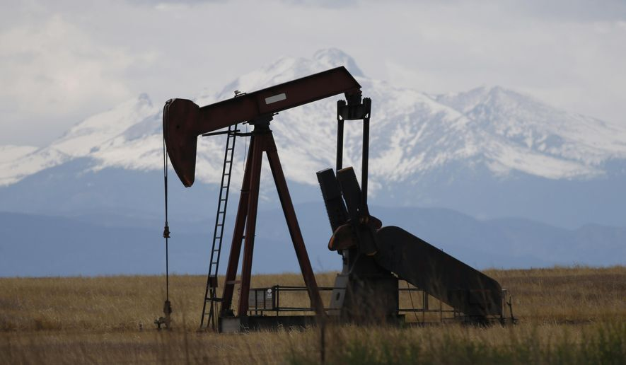 In this Friday, May 27, 2016, photo, a pump jack works off state highway 119 near Firestone, Colo.  (AP Photo/David Zalubowski, File)  **FILE**