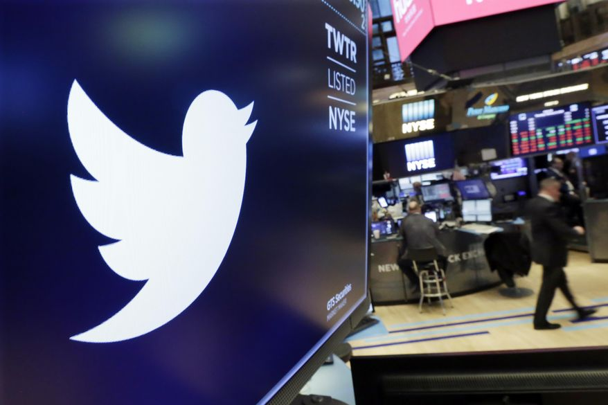 FILE - In this Feb. 8, 2018 file photo, the logo for Twitter is displayed above a trading post on the floor of the New York Stock Exchange.  Twitter Inc., on Friday, July 27 reported second-quarter net income of $100.1 million, after reporting a loss in the same period a year earlier.  On a per-share basis, the San Francisco-based company said it had net income of 13 cents. Earnings, adjusted for one-time gains and costs, were 17 cents per share. (AP Photo/Richard Drew, File)