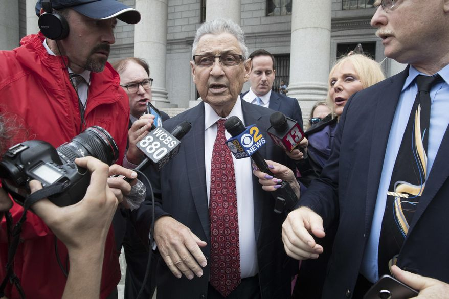 "Former New York Assembly Speaker Sheldon Silver, center, is surrounded by reporters as he leaves federal court in New York after his sentencing, Friday, July 27, 2018. Silver, a former New York Assembly speaker who brokered legislative deals for two decades before criminal charges abruptly ended his career, was sentenced Friday to seven years in prison by a judge who said political corruption in the state ""has to stop."" (AP Photo/Mary Altaffer)"