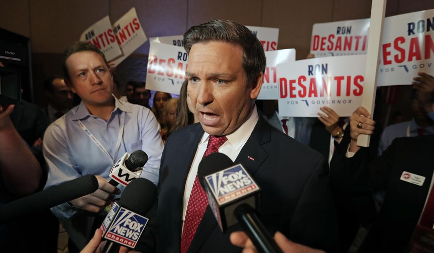 FILE - In this June 28, 2018 file phot,o U.S. Rep. Ron DeSantis speaks to reporters after a Florida Republican gubernatorial primary debate at the Republican Sunshine Summit in Kissimmee, Fla. Putnam is running against Florida Agriculture Commissioner Adam Putnam, seeking the Republican nomination for Florida governor. (AP Photo/John Raoux, File)