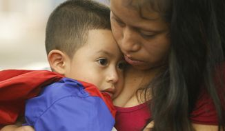 Maria holds her 4-year-old son Franco after he arrived at the El Paso International Airport Thursday, July 26, 2018 in El Paso, Texas. The two had been separated for over six weeks after being entering the country. (Ruben R. Ramirez/The El Paso Times via AP)