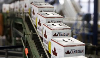 "FILE - In this Jan. 26, 2010, file photo, cans of Molson Canadian are boxed along the can line at the Molson Breweries in Vancouver, British Columbia. Molson Coors Brewing Company says it is not giving away free beer, despite a coupon offer circulating online. The false offer asks users to fill out a survey to win a free 24-pack of beer. Jessica Teixeira, a Molson Coors spokeswoman, told The Associated Press that the website ""is absolutely not genuine, nor is it run or endorsed by Molson Coors."" (Jonathan Hayward/The Canadian Press via AP, File)"