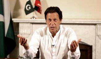 "In this photo provided by the office of Pakistan Tehreek-e-Insaf party, Pakistani politician Imran Khan, chief of Pakistan Tehreek-e-Insaf party, delivers his address in Islamabad, Pakistan, Thursday, July 26, 2018. Khan declared victory Thursday for his party in the country's general elections, promising a ""new"" Pakistan following a vote that was marred by allegations of fraud and militant violence. (Tehreek-e-Insaf via AP)"