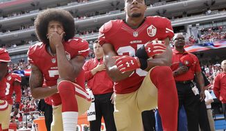 FILE - In this Oct. 2, 2016 file photo, San Francisco 49ers quarterback Colin Kaepernick, left, and safety Eric Reid kneel during the national anthem before an NFL football game against the Dallas Cowboys in Santa Clara, Calif.  As NFL training camps open, let's not forget two players who aren't suiting up. Kaepernick and Reid clearly are good enough to be playing, but the league has decided to make an example of them, a clear warning that only so much social activism will be tolerated.  (AP Photo/Marcio Jose Sanchez, File)
