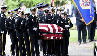 Pallbearers carry the casket of corrections officer Joseph Gomm to his resting place at Roselawn Cemetery in Roseville, Minn. on Thursday, July 26, 2018.The 45-year-old corrections officer was killed by an inmate at the Stillwater prison last week. Gomm is the first prison guard killed in the line of duty in Minnesota. (Jean Pieri/Pioneer Press via AP)