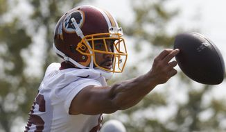 Washington Redskins tight end Jordan Reed (86) reaches for a pass during the morning session of NFL football training camp in Richmond, Va., Friday, July 27, 2018. (AP Photo/Steve Helber) **FILE**