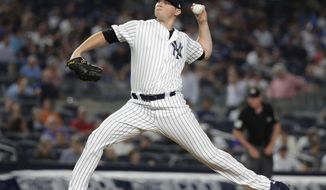 New York Yankees' Zach Britton delivers a pitch during the eighth inning of the team's baseball game against the Kansas City Royals on Thursday, July 26, 2018, in New York. (AP Photo/Frank Franklin II)
