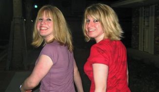 In this December 2008 photo, Sara Ellis, left, poses for a photo with her sister Rachel Ellis in Melbourne, Fla. Sara Ellis, working a summer job at a North Carolina mountain lodge, was out hiking when, authorities say, a co-worker attacked her and left her lifeless body steps from a famed scenic highway. (Nicole de Giovine via AP)