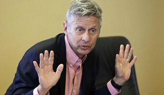 In this May 18, 2016, file photo, Libertarian presidential candidate and former New Mexico Gov. Gary Johnson speaks with legislators at the Utah State Capitol in Salt Lake City. Former Libertarian Party presidential candidate Johnson is considering jumping into the race for U.S. Senate in New Mexico as the current Libertarian candidate prepares to drops out, Johnson consultant Ron Nielson told The Associated Press on Friday, July 27, 2018. (AP Photo/Rick Bowmer, File)
