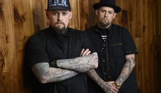 FILE - This July 10, 2018 file photo shows Benji Madden, left, and his twin brother Joel Madden of the rock band Good Charlotte in Burbank, Calif. The city of Annapolis, Md. will hold a benefit concert on July 28 featuring the Maryland-based band to honor the five Capital Gazette employees killed in an attack in their newsroom. (Photo by Chris Pizzello/Invision/AP)