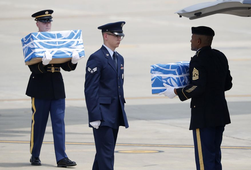Soldiers carry caskets containing remains of U.S. soldiers who were killed in the Korean War during a ceremony at Osan Air Base in Pyeongtaek, South Korea, Friday, July 27, 2018. North Korea on Friday returned the remains of what are believed to be U.S. servicemen killed during the Korean War, the White House said, with a U.S military plane making a rare trip into North Korea to retrieve 55 cases of remains. (Kim Hong-Ji/Pool Photo via AP)