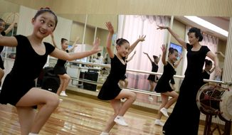 In this Thursday, July 26, 2018, photo, girls dance in a studio at the Mangyongdae Children's Palace in Pyongyang, North Korea. Mangyongdae Children's Palace is for talented school children to attend extracurricular classes and a popular place for tourists to visit during their stay in the capital. (AP Photo/Dita Alangkara, File)