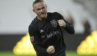 D.C. United forward Wayne Rooney celebrates his first MLS goal during the first half of a soccer match against the Colorado Rapids in Washington, Saturday, July 28, 2018. (AP Photo/Susan Walsh) ** FILE **