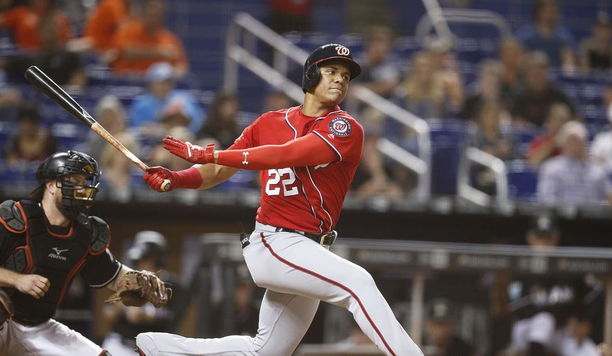 Washington Nationals right fielder Juan Soto hits the ball during the seventh inning of a baseball game against the Miami Marlins, Saturday, July 28, 2018, in Miami. Marlins won 2-1. (AP Photo/Brynn Anderson) ** FILE **