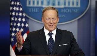 In this Tuesday, June 20, 2017, file photo, then-White House press secretary Sean Spicer smiles as he answers a question during a briefing at the White House in Washington. (Associated Press) **FILE**