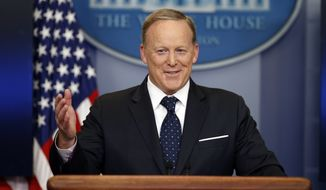 In this Tuesday, June 20, 2017, file photo, then-White House press secretary Sean Spicer smiles as he answers a question during a briefing at the White House,  in Washington.  A black man has accused the former White House press secretary of calling him a racial slur when they were students at a Rhode Island prep school. Spicer was at a book signing in Middletown on Friday, July 27 to promote his new book reflecting on his time at the press podium for President Donald Trump. Cambridge, Mass., resident Alex Lombard yelled out Spicers name and accused Spicer of calling him the N-word and trying to fight him when they attended Portsmouth Abbey School.(AP Photo/Alex Brandon, File)