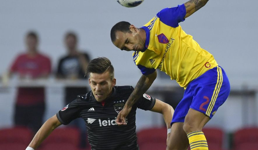 D.C. United midfielder Zoltan Stieber (18) and Colorado Rapids defender Edgar Castillo (2) battle for the ball during the first half of an MLS soccer match in Washington, Saturday, July 28, 2018. (AP Photo/Susan Walsh)