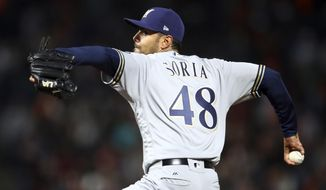 Milwaukee Brewers pitcher Joakim Soria works against the San Francisco Giants in the seventh inning of a baseball game Friday, July 27, 2018, in San Francisco. (AP Photo/Ben Margot)