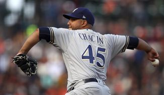 Milwaukee Brewers pitcher Jhoulys Chacin works against the San Francisco Giants in the first inning of a baseball game Saturday, July 28, 2018, in San Francisco. (AP Photo/Ben Margot)