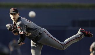 Arizona Diamondbacks starting pitcher Patrick Corbin works against a San Diego Padres batter during the first inning of a baseball game Saturday, July 28, 2018, in San Diego. (AP Photo/Gregory Bull)