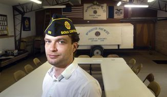 In this July 10, 2018 photo, Jeremy Kruid, commander of the American Legion Post in Boyden, poses for a photo in Boyden, Iowa. Kruid hopes that the efforts he's made as commander of the Wm. Monster American Legion Post No. 272 in Boyden can show younger veterans what's possible if they step up and join. (Justin Wan/Sioux City Journal via AP)